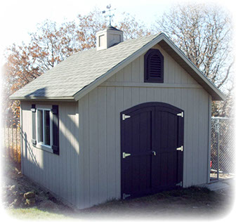 Apex custom shed with arch top carriage house doors