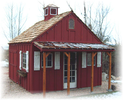 Custom apex shed with batten and board siding and cupola