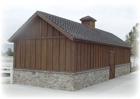 custom horse shed with cupola and batten and board siding